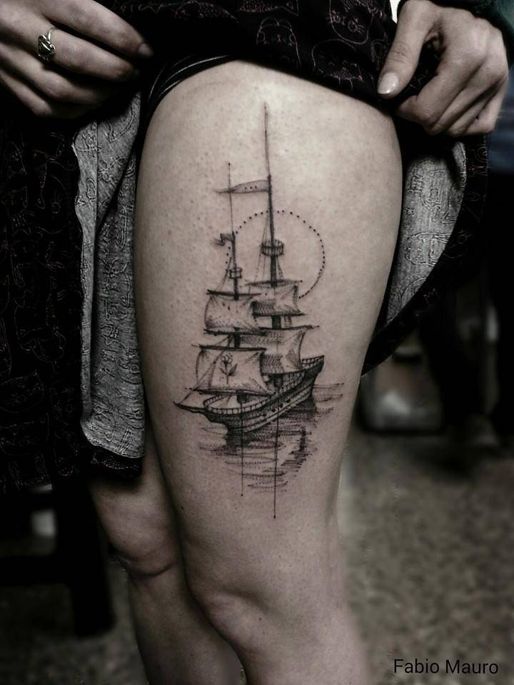 Sailing ship tattoo on the thigh