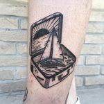Ship in a suitcase tattoo