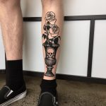 Skull vase and rose tattoo