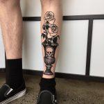 Skull vase and rose tattoo