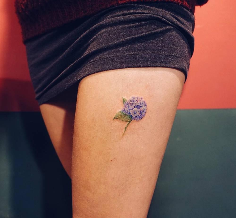 Small hydrangea tattoo on the left thigh