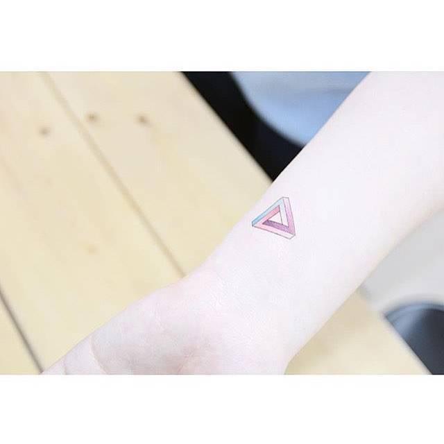 Small penrose triangle tattoo