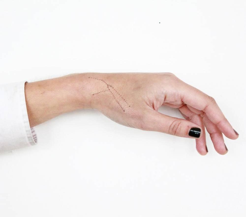 Small taurus constellation tattoo on the wrist