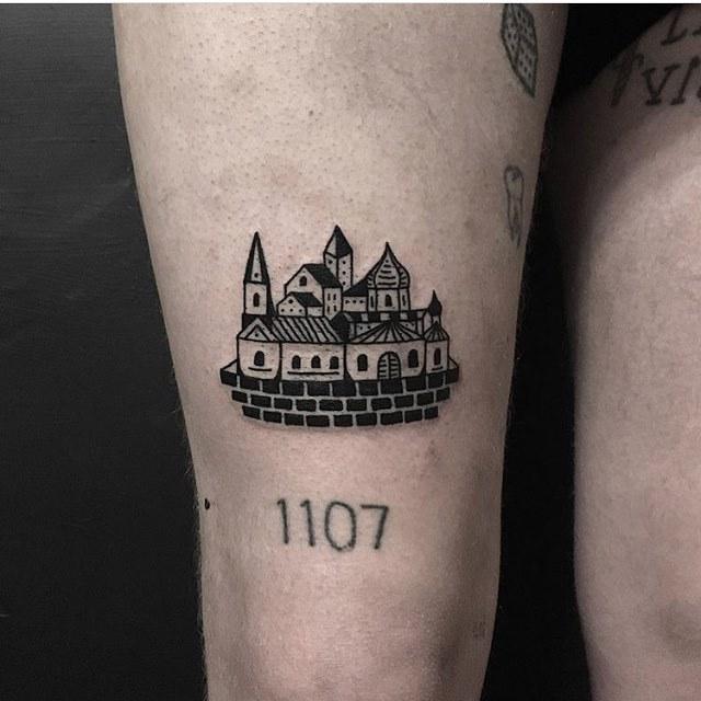 Small blackwork town tattoo