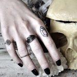 Small crystal tattoo on the index finger