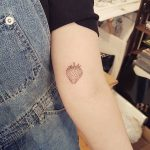 Small strawberry tattoo by sarah march
