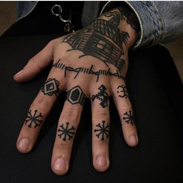 Snowflake tattoos on fingers