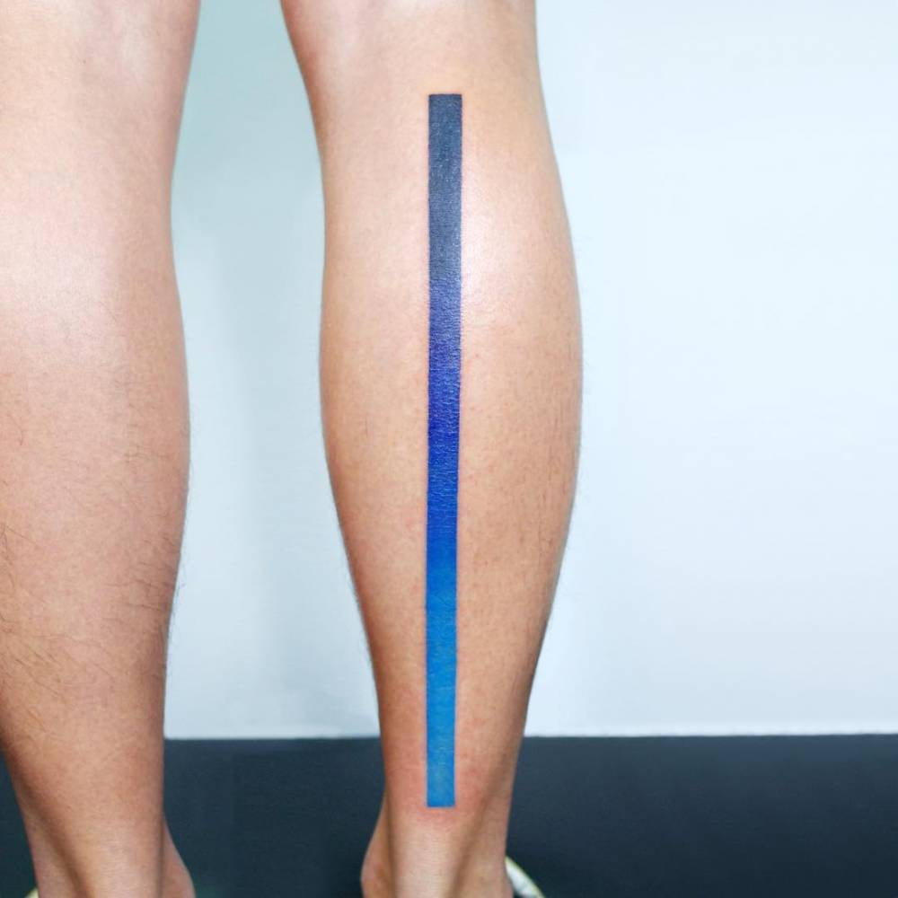 Spectrum line tattoo on the right calf