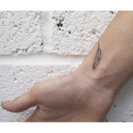Stick and poke feather tattoo