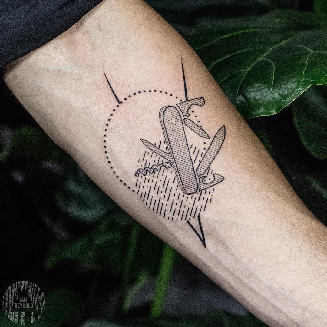 Swiss army knife tattoo