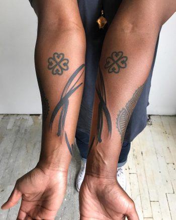 Symmetrical brushstrokes tattoos