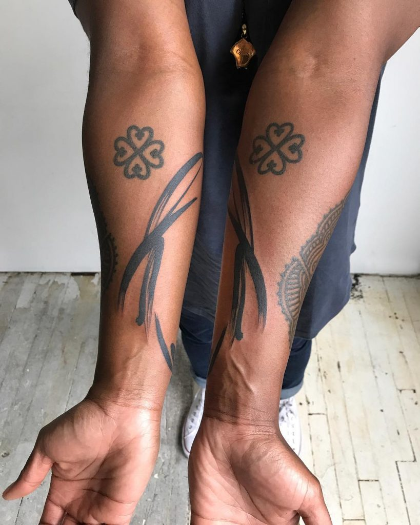 Symmetrical brushstrokes tattoos