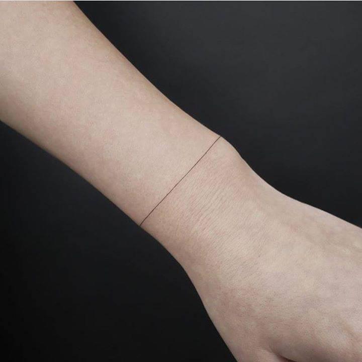 Thin minimalist line tattoo