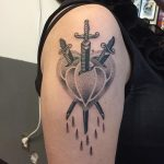 Three sword stabbed heart tattoo