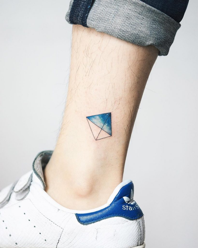 Tiny kite tattoo on the ankle