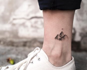Tiny mountain tattoo on the ankle