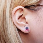 Tiny spider tattoo on the ear