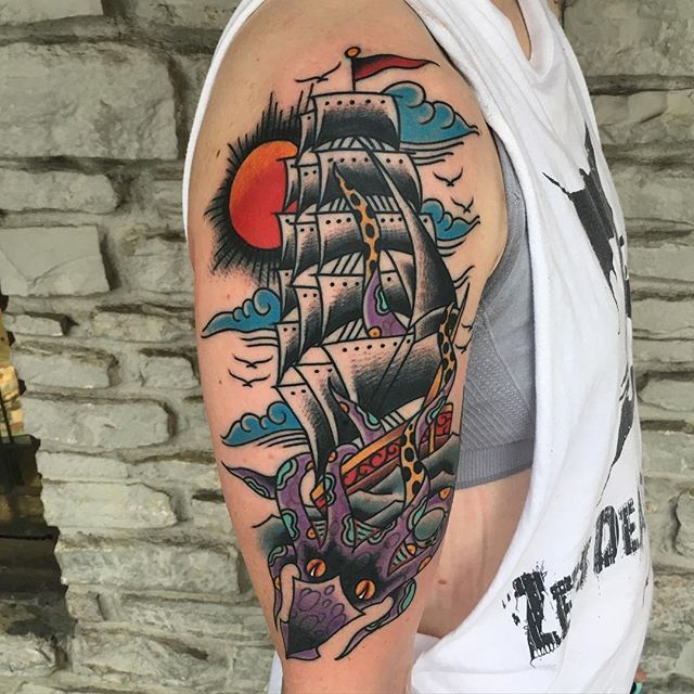 Traditional ship and squid tattoo