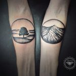 Tree and mountain tattoos