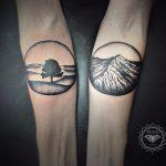 Tree and mountain tattoos