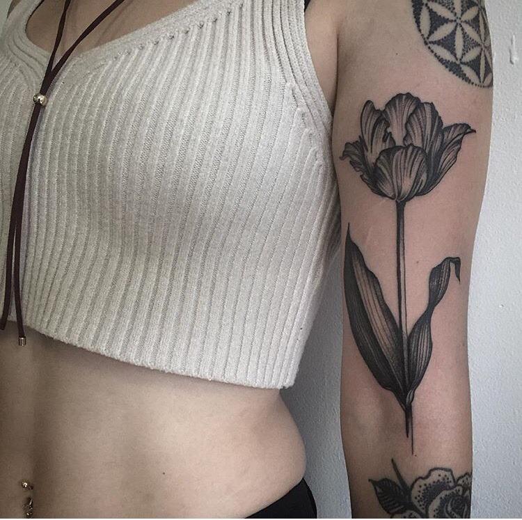 Tulip tattoo on the arm by joseph bryce