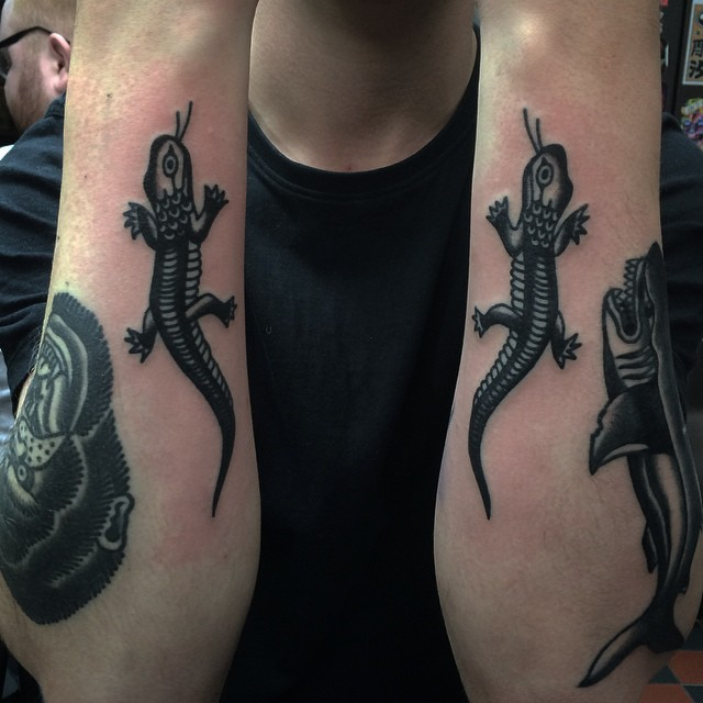 Two black lizard tattoos