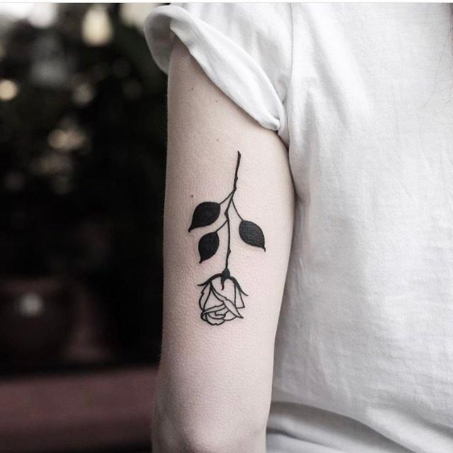 Upside down rose tattoo by jonas
