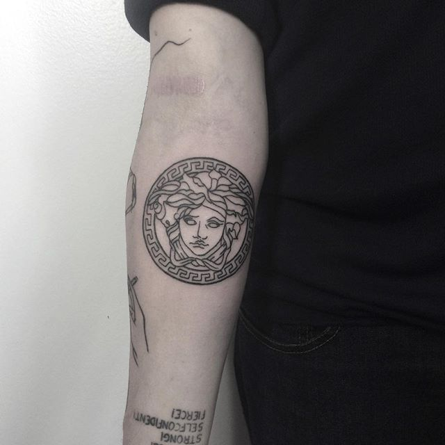 Versace logo tattoo