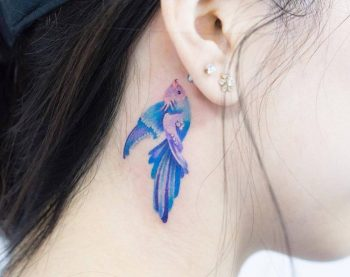 Watercolor fish tattoo on the neck