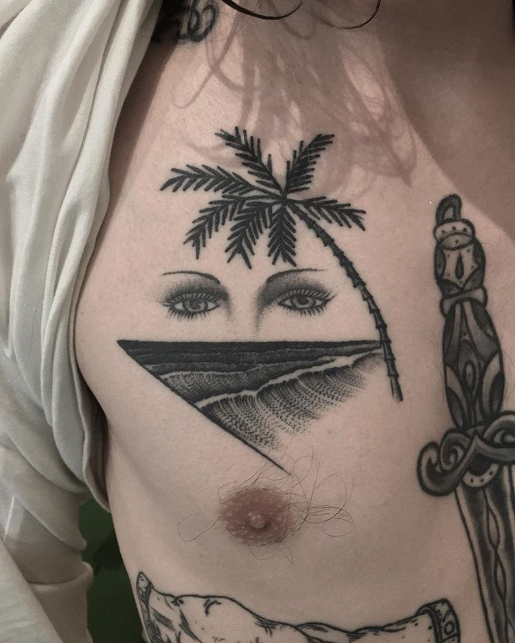 Waves, palm tree and eyes tattoo