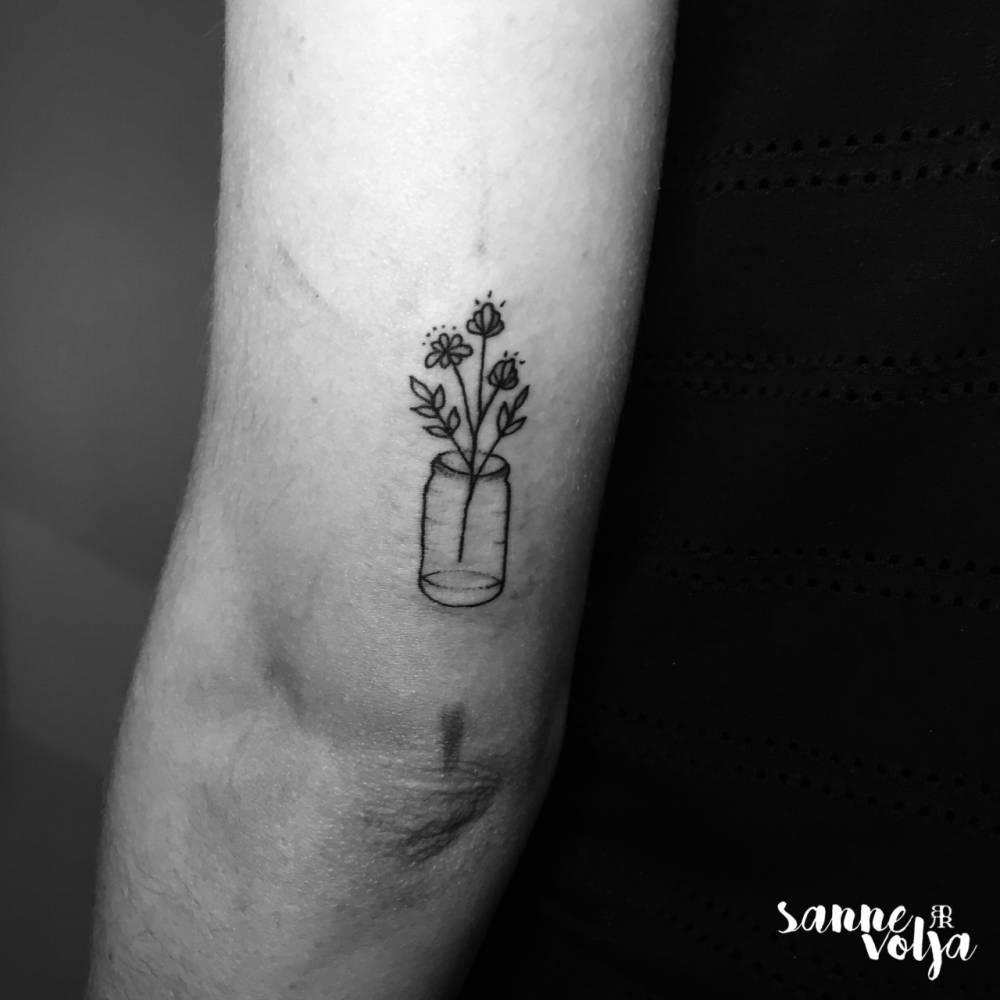 Wild flowers in a jar tattoo