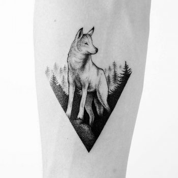 Wolf in a triangle tattoo