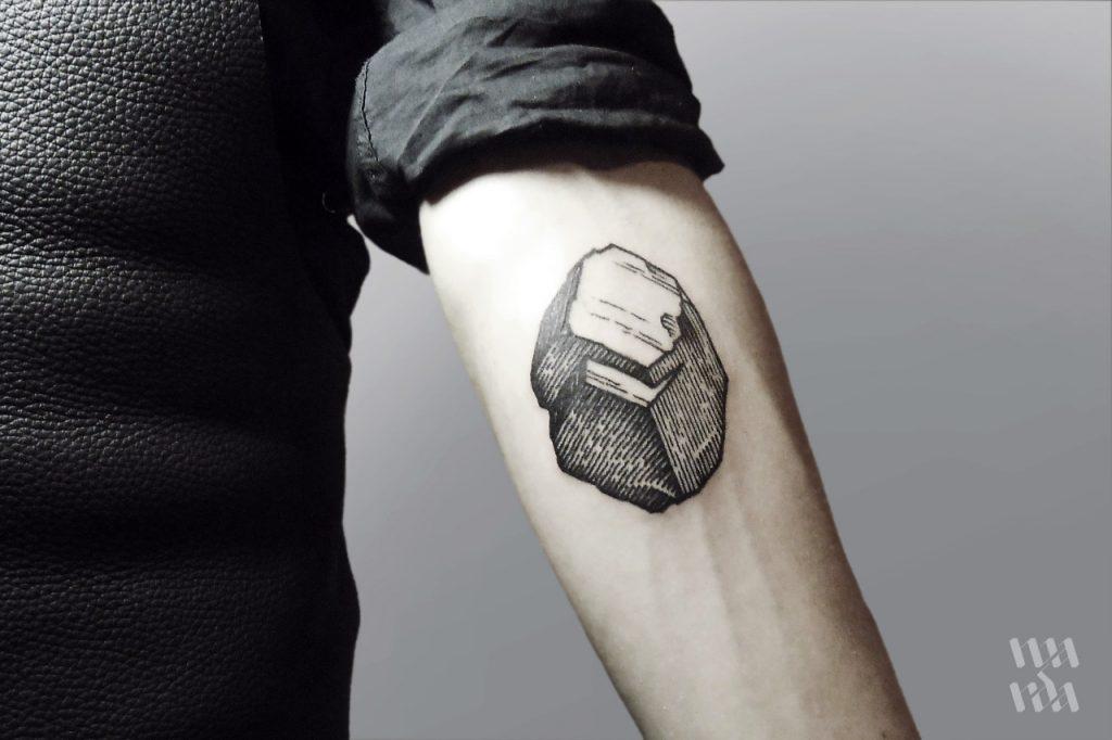 Woodcut coal tattoo
