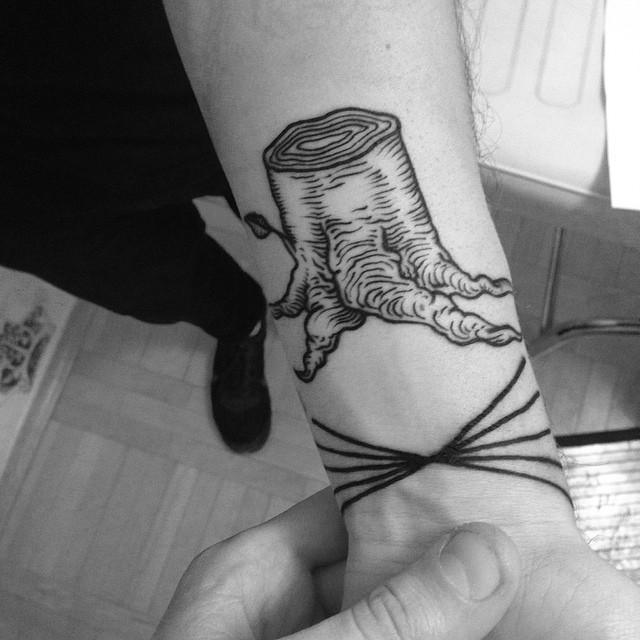 Woodcut stump tattoo
