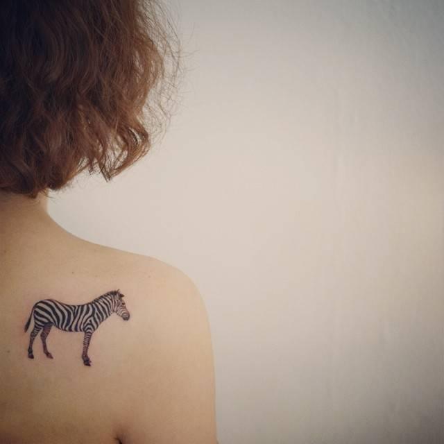 Zebra tattoo on rihgt shoulder blade