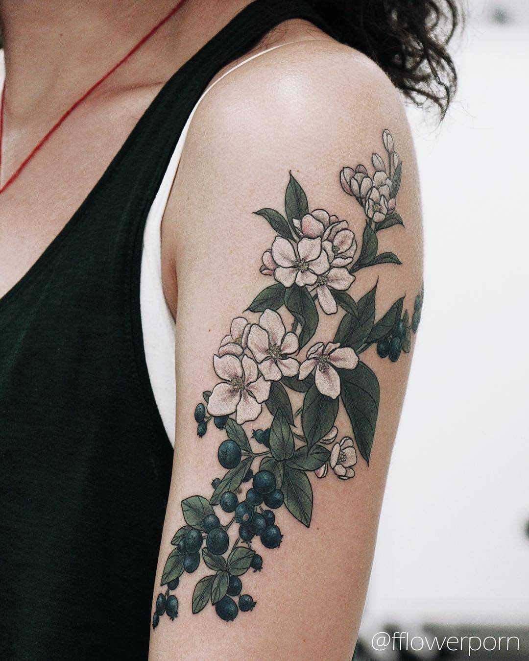 Apple blossoms and blueberries tattoo
