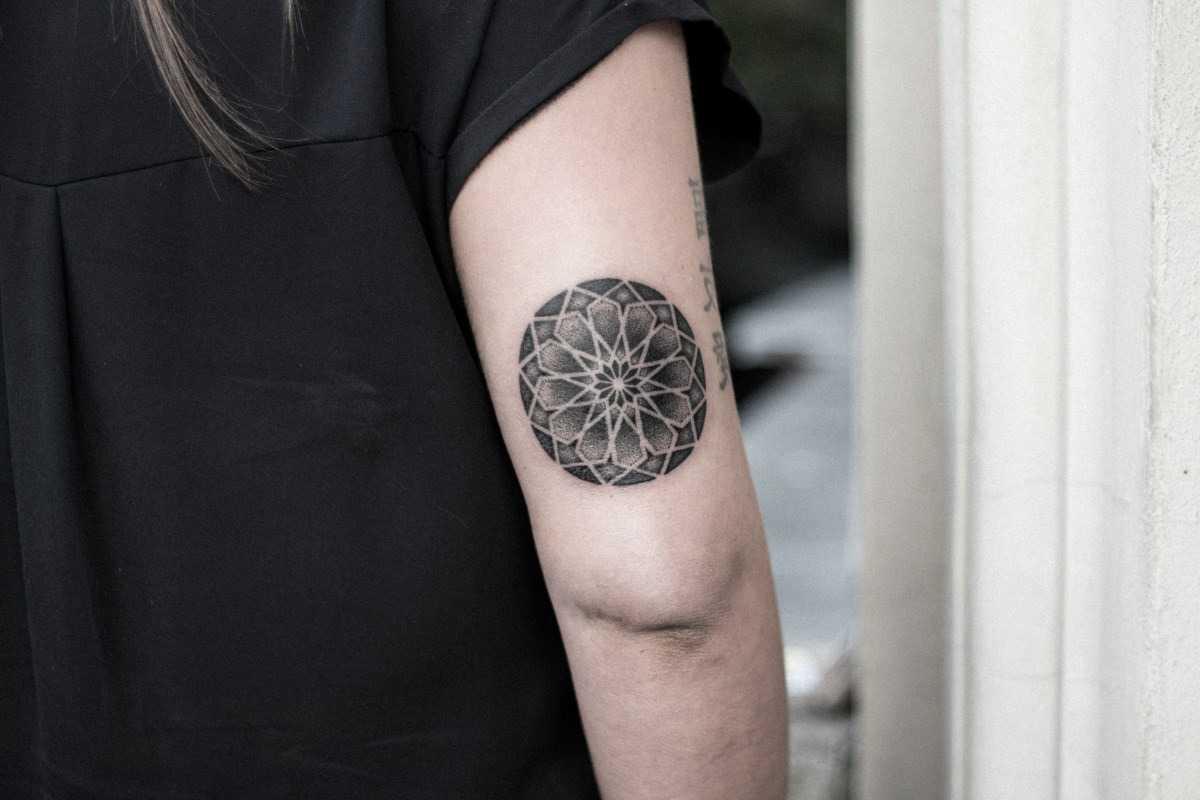 Black and white mandala tattoo by dogma noir