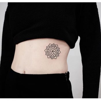 Black floral mandala tattoo by jonas ribeiro