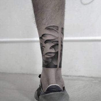 Black gradient waves tattoo