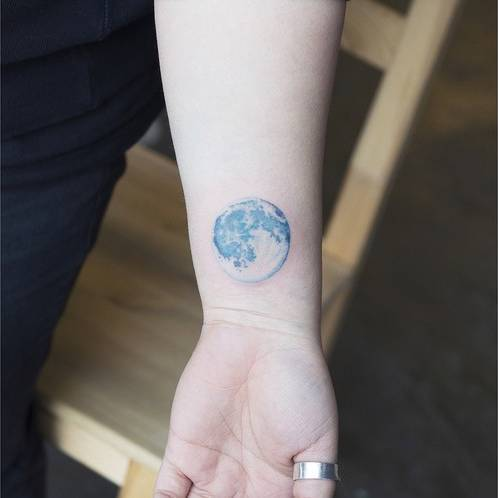 Blue moon tattoo on the wrist