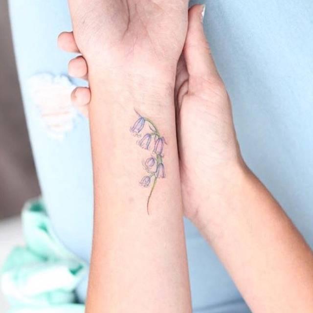 Bluebell flower tattoo on the wrist