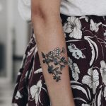 Blueberries tattoo on the forearm