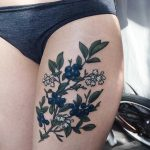 Blueberry tattoo on the thigh