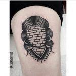 Brickwall face tattoo