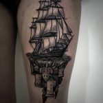 Castle and ship tattoo
