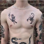Cigarette and scorpion tattoos