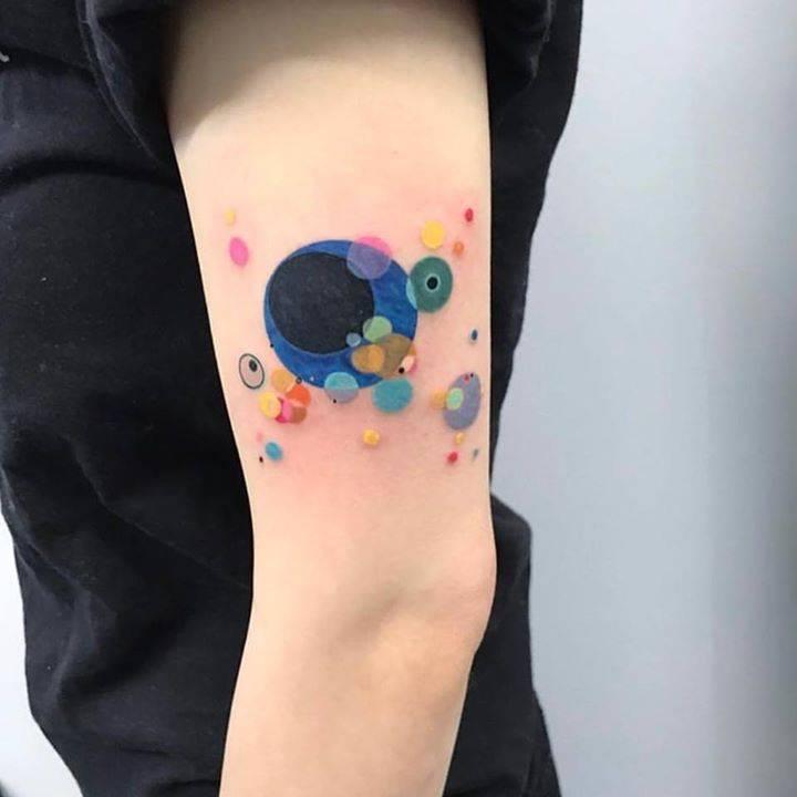 Colorful circles tattoo by eva krbdk