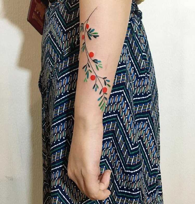 Colorful plant tattoo by tattooist zihee