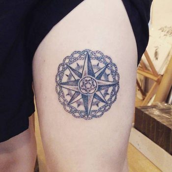Compass rose on the thigh