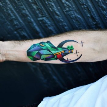 Crocodile with a crescent moon tattoo
